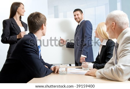 A businessman making a report and four people listening to him - stock photo