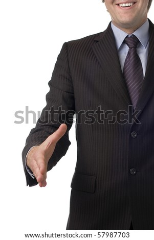 A businessman offering a hand for handshake. Isolated on white background - stock photo