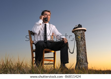 a businessman on phone in the countryside - stock photo