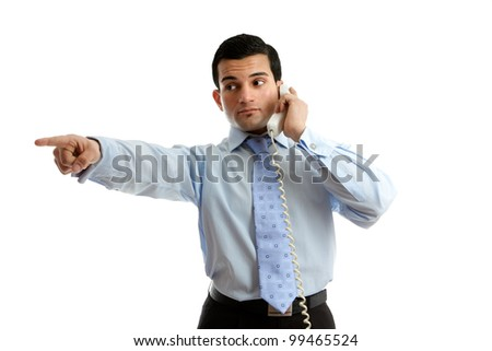 A businessman on the telephone pointing at your message or giving orders.  White background.