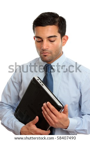 A businessman, or IT consultant holding a laptop computer.  White background. - stock photo