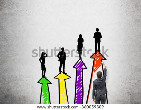A businessman painting four vertical arrows of different colours that are arranged like a bar chart, four people standing on them. Back view. Concrete background. Concept of career growth. - stock photo