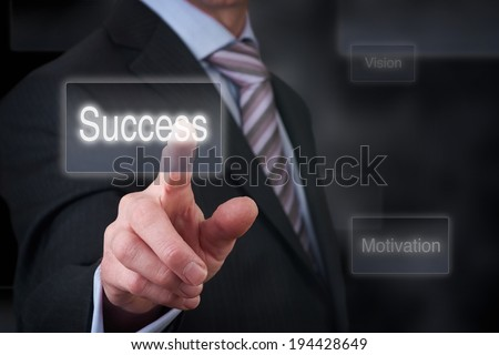 A businessman pointing his finger with a graph concept showing success. - stock photo