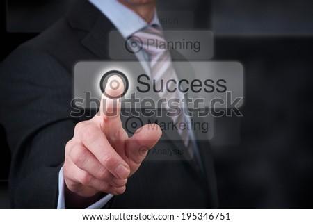 A Businessman pressing a  success button concept. - stock photo