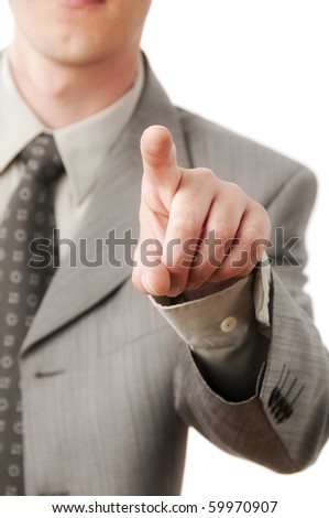 A businessman pressing a virtual button isolated against a white background - stock photo