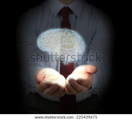 A businessman protecting and idea concept of intellectual property - stock photo