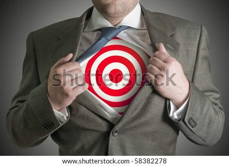 A businessman pulling back his skirt to reveal a target symbol. - stock photo