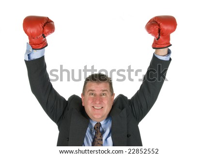 A businessman raises his arms in victory during contract negotiations.