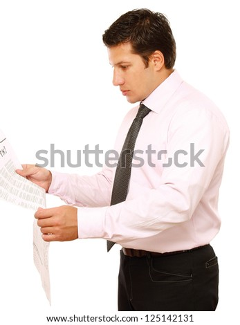 A businessman reading a newspaper, isolated on white background - stock photo