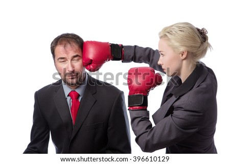 A businessman receiving punch to the side of his head from his co-worker isolated on white background - stock photo