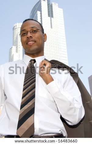 A businessman relaxes and throws his jacket over his shoulder.