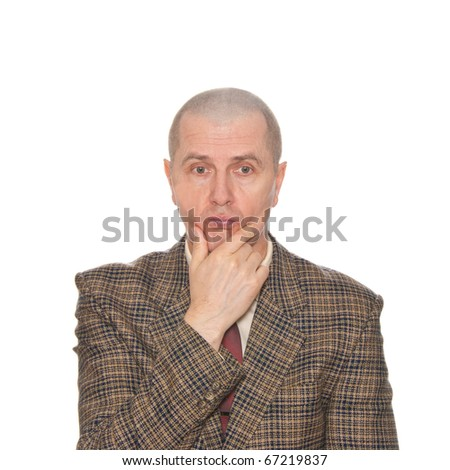 A businessman rubbing his chin. Isolated on white. Body language. Indecision. Uncertainty. - stock photo