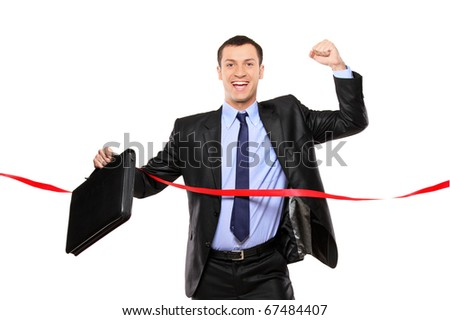 A businessman running at the finish line isolated on white background - stock photo