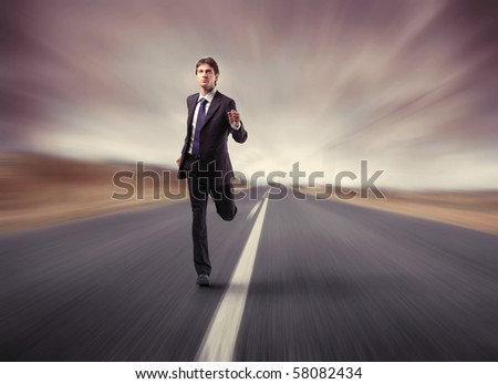 a businessman running on the road - stock photo