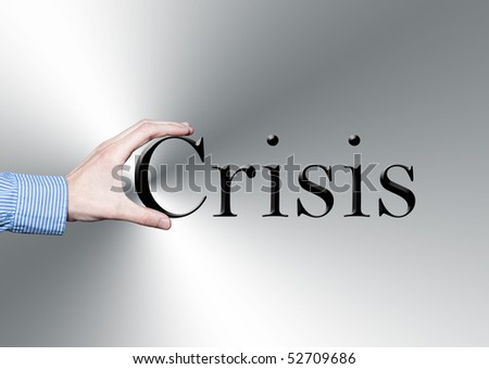 A businessman's hand holding the word crisis - stock photo