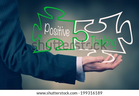 A Businessman's hand holding the words Positive Thinking. - stock photo
