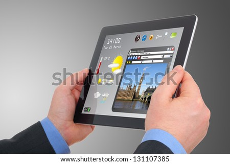 a businessman searching a tourism information on pad - stock photo