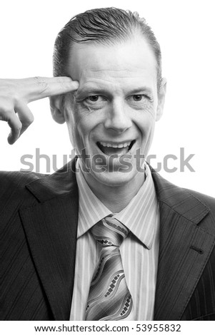 A businessman shooting himself with his finger. black and white - stock photo