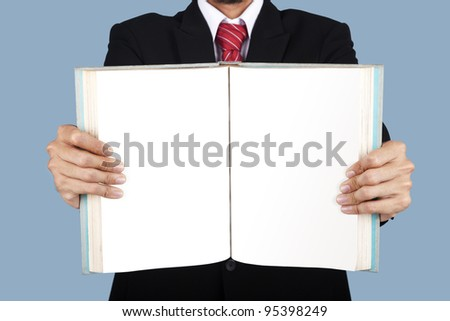 A businessman showing a blank pages of a book - stock photo