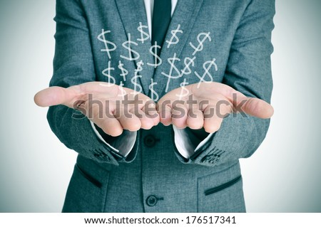 a businessman showing a pile of drawn dollar sign in his hands - stock photo