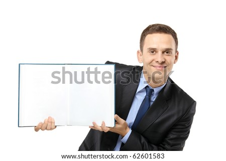 A businessman showing a white blank book, providing excellent copy space for your image, text or logo, isolated on white background