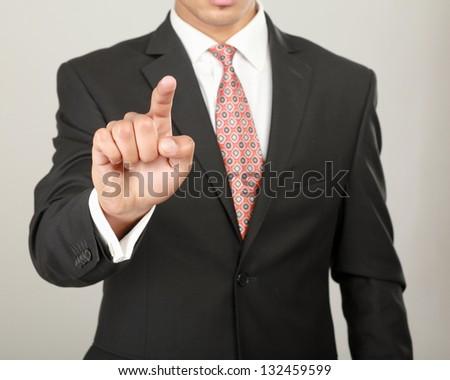 A businessman showing something isolated on white background - stock photo