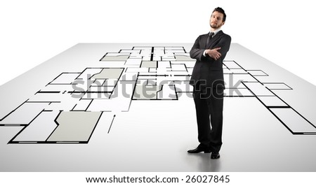 a businessman standing up on a digital blueprint - stock photo