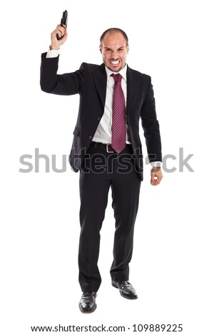 a businessman standing with a gun - stock photo