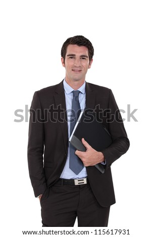 A businessman standing with his folder. - stock photo