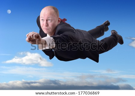 a businessman superhero flying to success