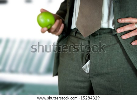 A businessman talking on a break - unaware of a escalating embarrassing moment... - stock photo