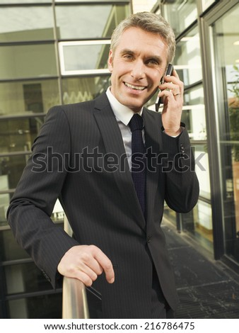 A businessman talking on his mobile phone.