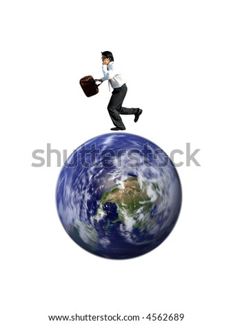 A businessman talking on the phone and running on a spinning globe (the globe image is provided free of licensing fees by NASA: http://visibleearth.nasa.gov/view_rec.php?id=2429) - stock photo