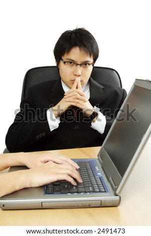 A businessman thinking during a business meeting - stock photo