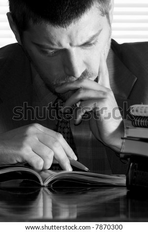 A businessman thinking over his papers