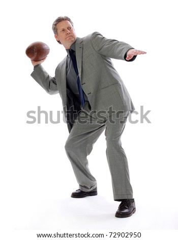 A businessman throwing a football aims for success with positive direction - stock photo