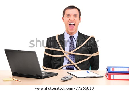 A businessman tied up with rope in the office isolated on white background - stock photo