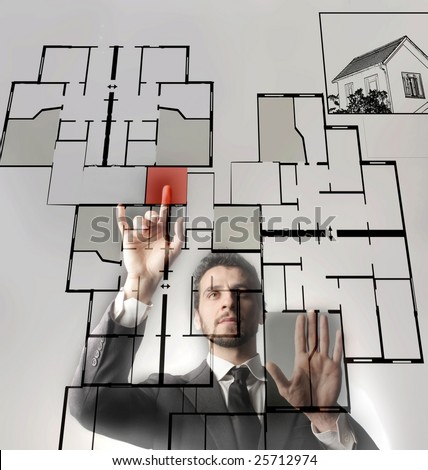 a businessman touching a digital blueprint of home - stock photo