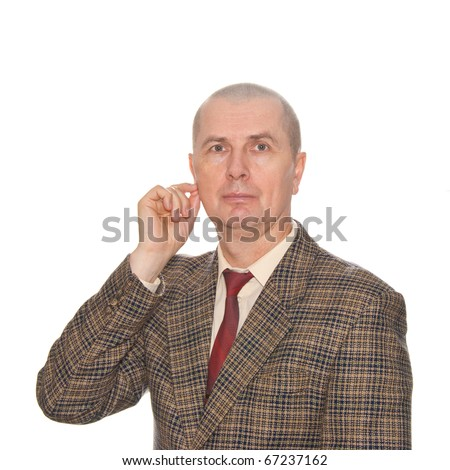 A businessman touching his ear. Isolated on white. Body language. Don't wont listening somebody lying. - stock photo