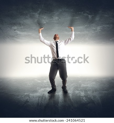 A businessman trapped by anxiety and fear - stock photo