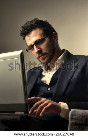 a businessman using a laptop - stock photo