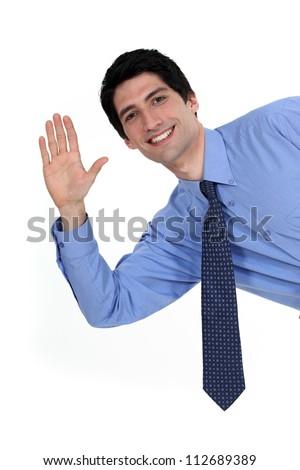 A businessman waving. - stock photo