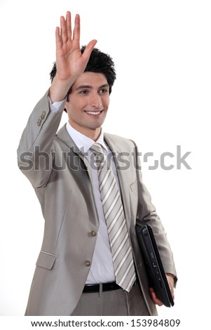 A businessman waving - stock photo