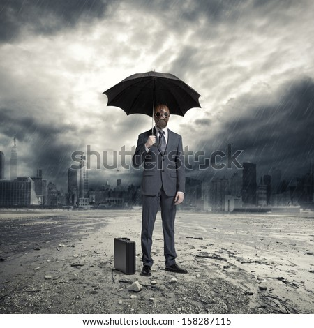 A businessman wearing a gas mask, standing in the rain
