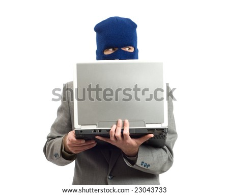 A businessman wearing a mask using a laptop computer to change his identity - stock photo