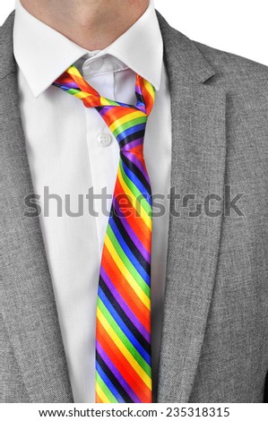 a businessman wearing a rainbow necktie - stock photo