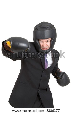 A businessman wearing boxing gear isolated on white - stock photo