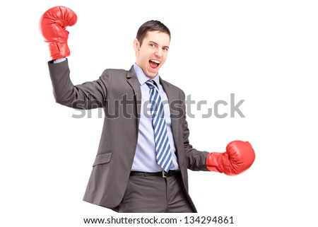 A businessman wearing red boxing gloves and gesturing happiness isolated on white background - stock photo