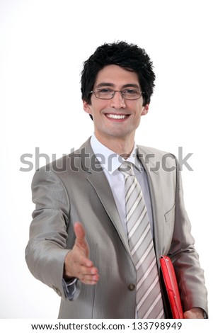 A businessman welcoming a customer. - stock photo