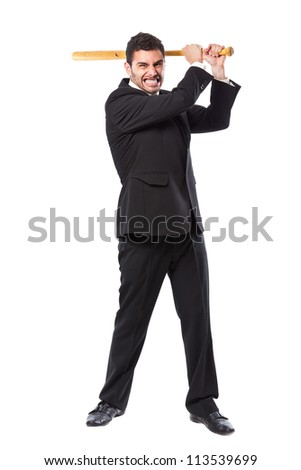 a businessman with a baseball bat standing over white background